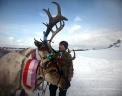 Житель поселка Ербогачен Иркутской области на ежегодном празднике День оленевода на реке Нижняя Тунгуска. Фото: РИА Новости