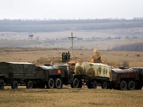 Украинские солдаты недалеко от российской границы на востоке Украины. Фото: Reuters